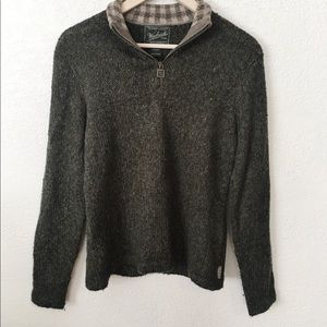 Dark green wood quarter-zip sweater